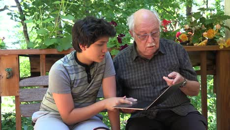 Boy-And-Grandfather-With-Computer-Zooms-In