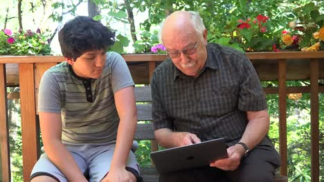 Boy-And-Grandfather-With-Computer