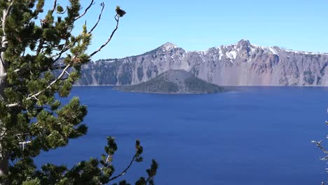 Oregon-Crater-Lake-Evergreen-Tree-Frames-View-With-Wizard-Island-Pan-And-Zoom