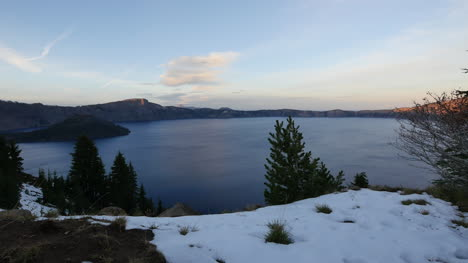 Oregon-Crater-Lake-In-Late-Evening-With-Snow-In-Foreground