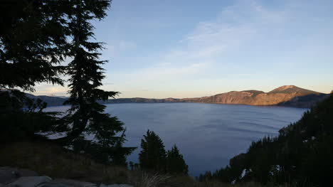 Oregon-Crater-Lake-View-With-Fir-Trees-In-Evening