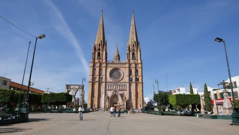 Mexico-Arandas-Crippled-Man-In-Plaza-With-Church