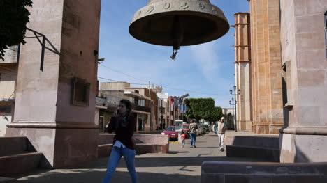 Mexico-Arandas-People-Walk-Under-Big-Bell