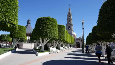 Mexico-San-Julian-Church-Tower-And-Plaza-With-Little-Boy