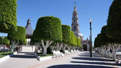Mexico-San-Julian-Plaza-With-Church-And-Bandstand-With-Man-And-Boy-Playing