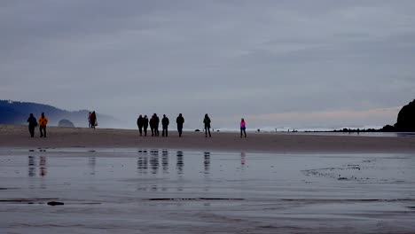 Oregon-People-On-Beach-After-Sunset-Zooms-In