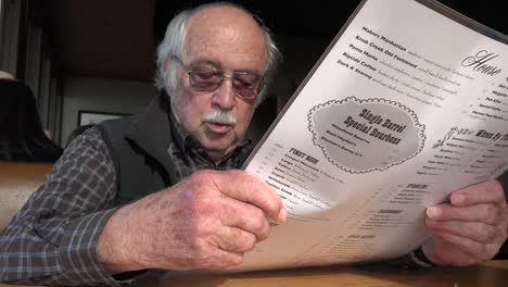 Oregon-Elderly-Man-Reads-Menu