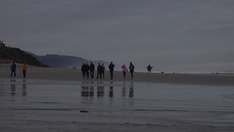 Oregon-People-Approach-Stream-On-Beach