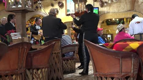 Mexico-Arandas-Musician-Play-At-Table