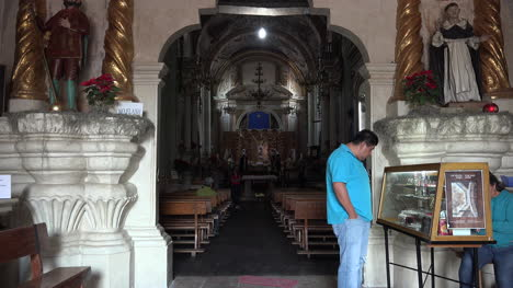 Mexico-Atotonilco-Man-Looks-At-Case-In-Church