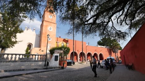 Mexico-Atotonilco-People-Cross-Street-In-Front-Of-Arches