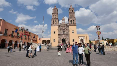 Mexico-Dolores-Hidalgo-Tourists-Pose-In-Front-Of-Church