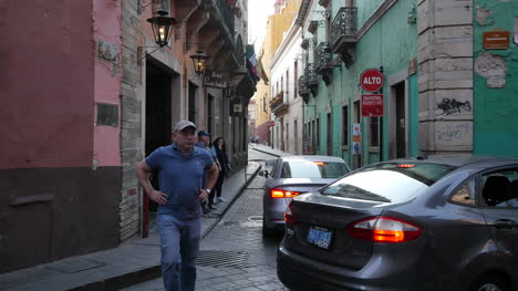 Mexico-Guanajuato-Man-Directs-Traffic-On-Narrow-Street