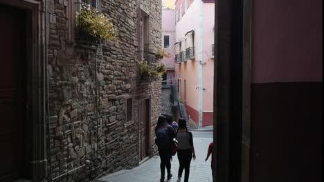 Mexico-Guanajuato-Three-People-In-Narrow-Street