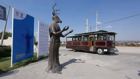 Mexico-San-Miguel-Statue-With-Deer-Head-And-Bus