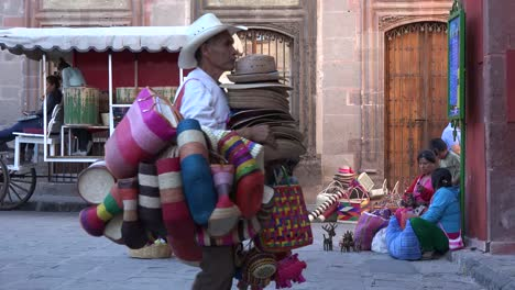 Mexico-San-Miguel-Zooms-On-Vendor-And-Man-With-Hats