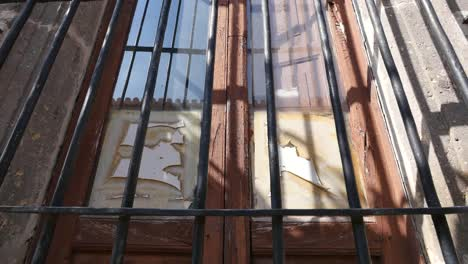 Mexico-Tlaquepaque-Broken-Window-With-Bars