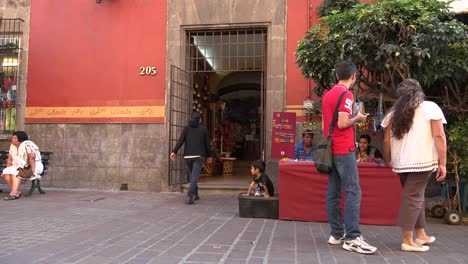 Mexico-Tlaquepaque-Craft-Stand-And-People
