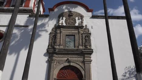 Mexico-Tlaquepaque-Door-Of-Parish-Church-With-Pigeon-Zoom-In
