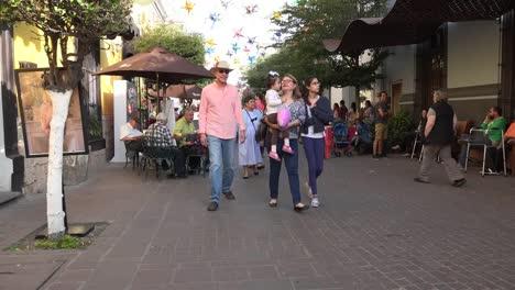 Mexico-Tlaquepaque-Family-Holding-Child