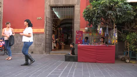 Mexico-Tlaquepaque-People-Pass-Craft-Stand