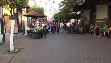 Mexico-Tlaquepaque-People-Walk-Then-Turn-To-Talk