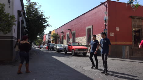 Mexico-Tlaquepaque-Street-With-Red-Buildings-And-Jogger