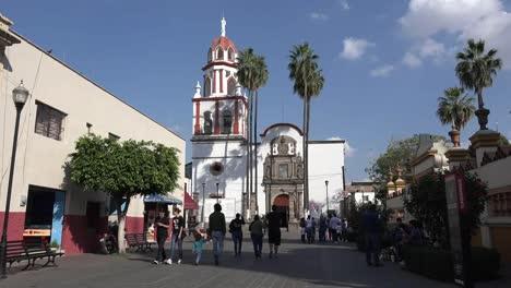 Mexico-Tlaquepaque-Walking-In-Plaza-By-Parish-Church
