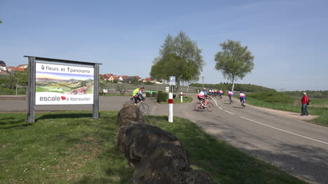 France-Alsace-Itterswiller-Bicyclers-Go-Up-Road