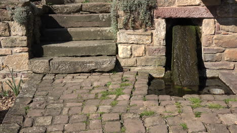 France-Steps-And-Water-On-Stone-Slab