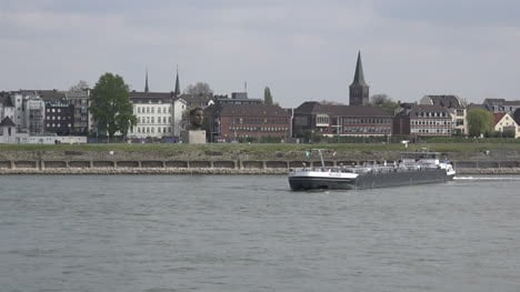 Germany-Duisburg-Barge-Turns-By-Church-Zoom-In
