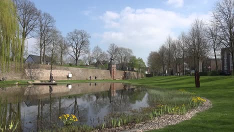 Germany-Rees-Pond-And-Medieval-Wall-With-Cloud