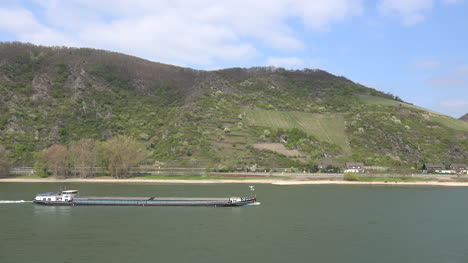 Germany-Barge-On-Rhine-With-Hills-And-Vineyards