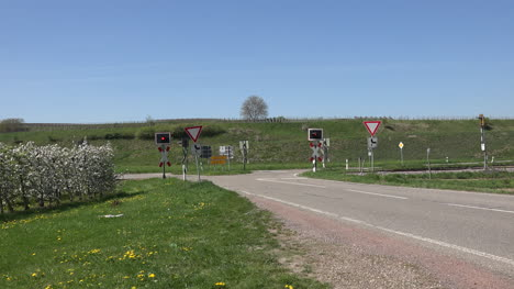 Germany-Train-Passes-Crossing-And-Orchards-With-Sound