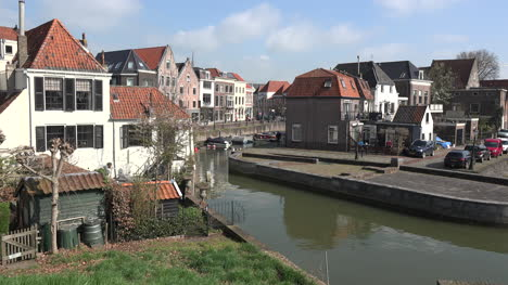 Netherlands-Schoonhoven-Canal-Houses-And-Bicycle-Racers