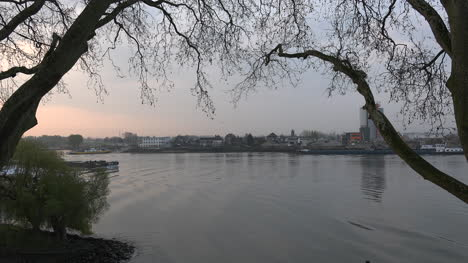 Netherlands-Barges-Pass-On-Lek-Distributary-Of-The-Rhine-At-Dawn-Time-Lapse