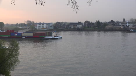 Netherlands-Container-Barge-On-Lek-River-At-Dawn-Time-Lapse