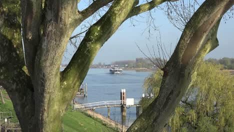 Netherlands-Cruise-Boat-Through-Trees-On-Der-Lek-Zoom-In