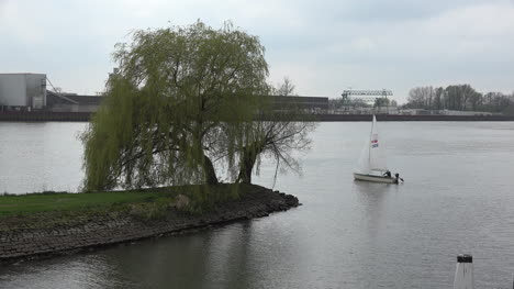 Netherlands-Sailboat-On-De-Lek-Zoom-In