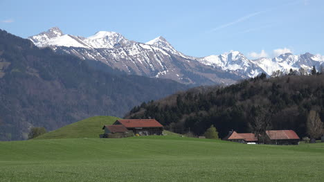 Switzerland-La-Gruyere-Landscape-And-Mountains-Zoom-Out