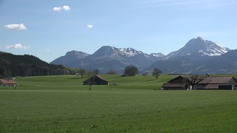 Switzerland-La-Gruyere-Mountain-Landscape-With-Barns