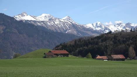 Switzerland-La-Gruyere-Mountains-Beyond-Meadow