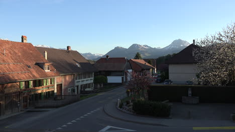 Switzerland-Town-With-Car-And-Mountains