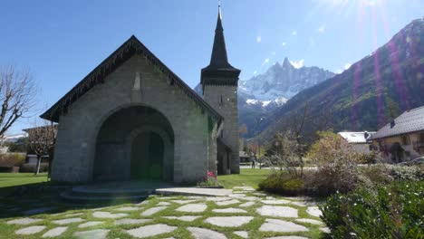 France-Chamonix-Church-With-Alps-And-Sun-Flare