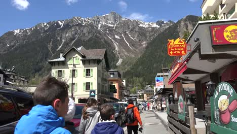 France-Chamonix-People-Walking-Down-Sidewalk