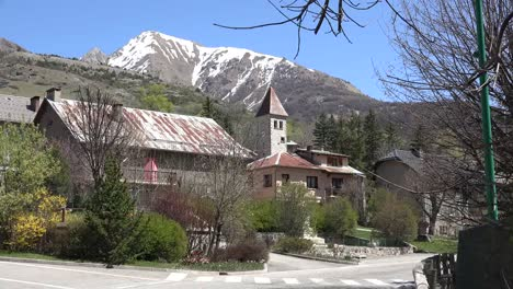 France-Meyronnes-Church-And-Mountain-In-A-Village