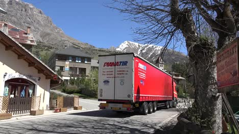 France-Meyronnes-Red-Truck-Drives-Through-Town