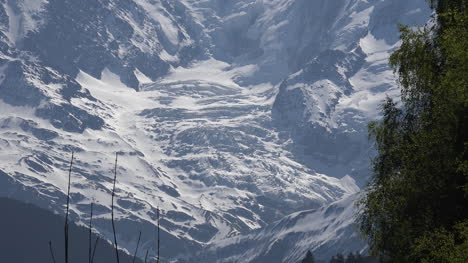 France-Mont-Blanc-Zooms-Out-From-Glacier-To-Traffic-On-Road