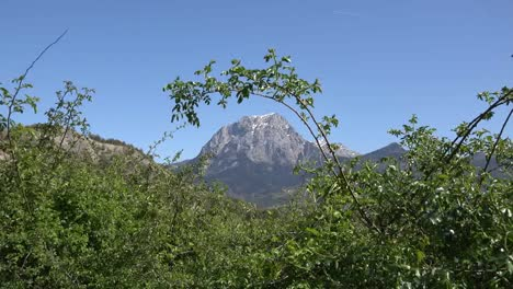 France-Alpine-Peak-Framed-By-Shrub-Near-Lac-Serre-Poncon-Zooms-In