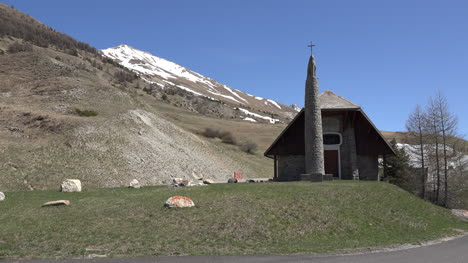 France-Car-Passes-Church-Near-The-Larche-Pass